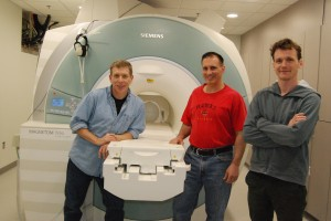Greg Berns, Mark Spivak, and Peter Cook by the MRI