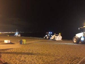 The Barcelona Beach at night. Night time was the right time for beach maintenance.