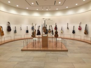 Phoenix, Arizona- Have you ever seen this many guitars? An introductory exhibit at the Musical Instrument Museum displaying the progression of guitar design from acoustic to electric.