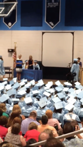 Psychiatric Service Dog Hank hears the accolades of the crowd while he walks up the steps during his recipient's high school graduation.