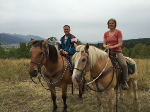 Mark and Lizzy agree that time on horseback is definitely more serene than battling GA 400 or I-285 rush hour traffic. Alpine, WY.