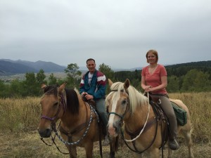 Mark and Lizzy pretending be a cowboy and cowgirl. Lizzy was a competition rider in her youth. Mark was a city boy. Alpine, WY..