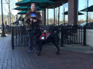 CPT Service Dog Trainer Lisa Carroll educating Hank in a public venue. Please note that CPT respects the confidentiality of our service dog clients. This story was approved by our client, who wishes to improve public knowledge of schizophrenia and the benefits provided by psychiatric service dogs.